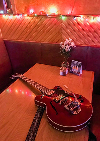Guitar on Table at Harry's - Photo Dec 0