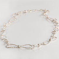 knots bow necklace thick silver.jpg