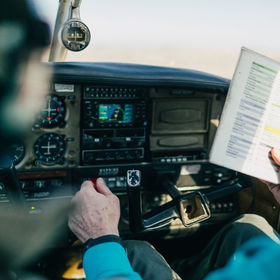 Flight instructor and student reviewing