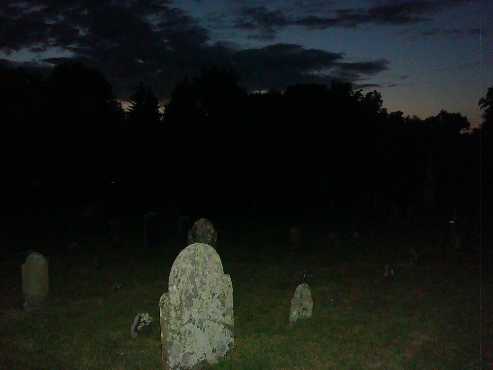 Nightfall at an old cemetery in NH