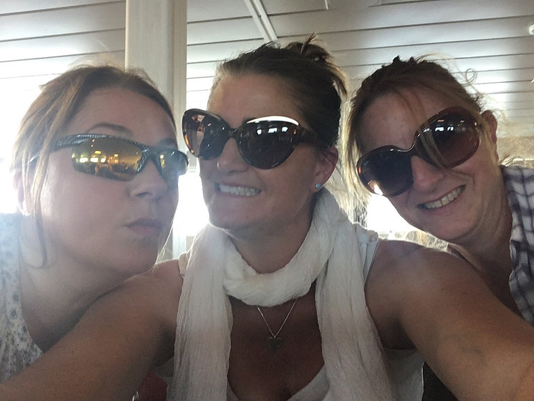 Three girlfriends taking a selfie on the Tiree Ferry: Homeopathy can help women through hormonal changes