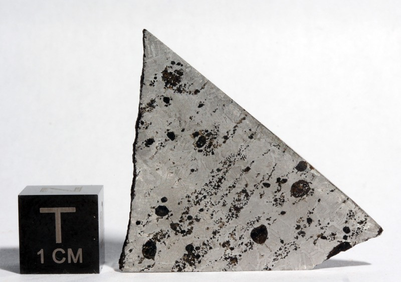 Fragment of the Bocaiúva meteorite, not grouped due to its peculiar characteristic, such as the presence of unusual silica inclusions in its kamacite matrix.  Image Credit: André Moutinho