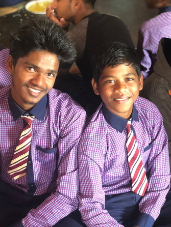 Some of the boys in their school uniforms during Sunday lunch.