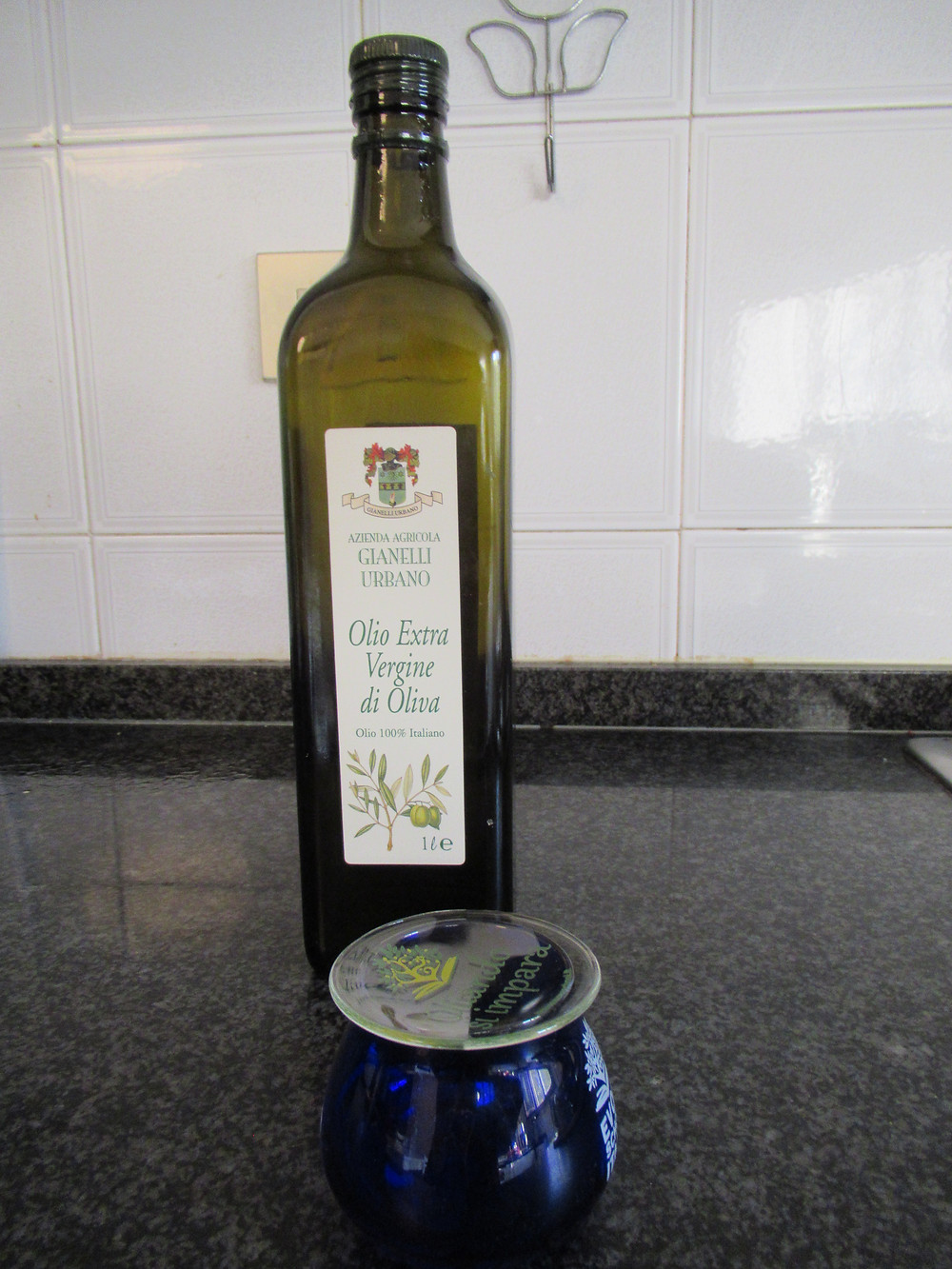 My bottle of EVOO and glass for tasting
