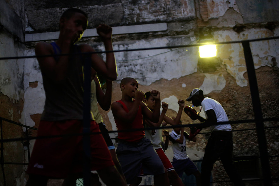 Children attend a boxing training session in Havana, Cuba March 3, 2014. Photo/Enrique de la Osa