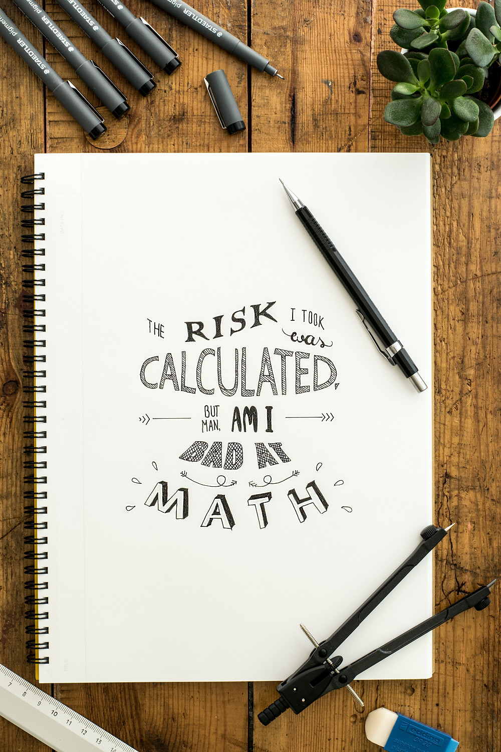 """A journal with a covert art based on """"calculated risk"""" is featured in a still photograph."""
