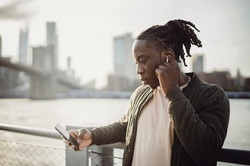 A man looks at a digital advertisement on a mobile phone, part of a successful multichannel digital marketing strategy.