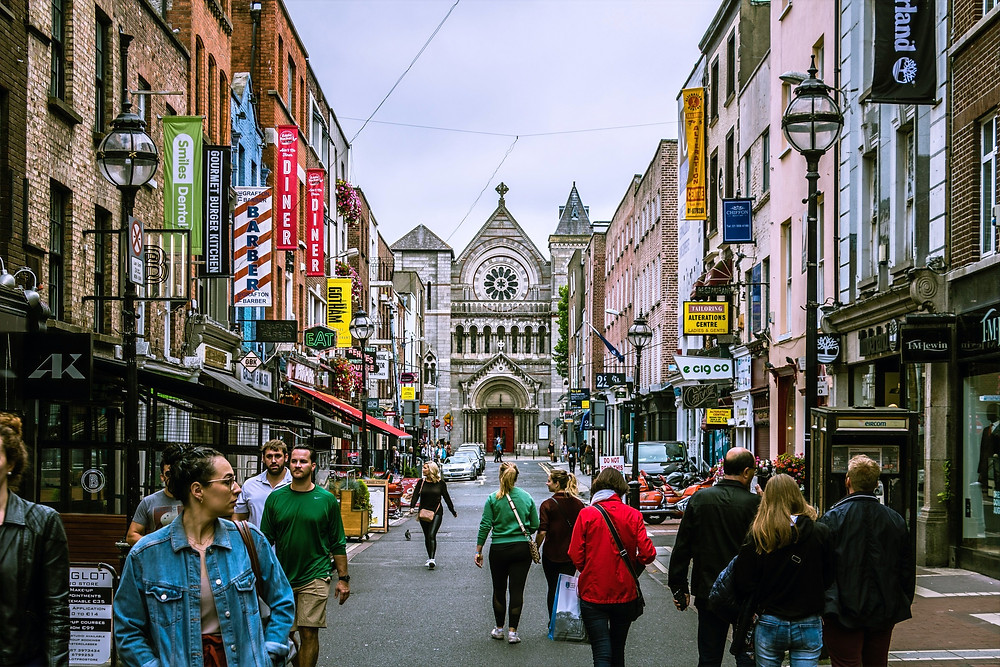 A photograph of a cathedral at the end of a busy street in Dublin.