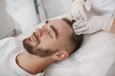 young-man-with-hairloss-problem-receivin