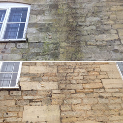 Steam cleaning stone wall