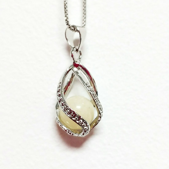 The Twist Drop Bead Cage Inclusion Pendant