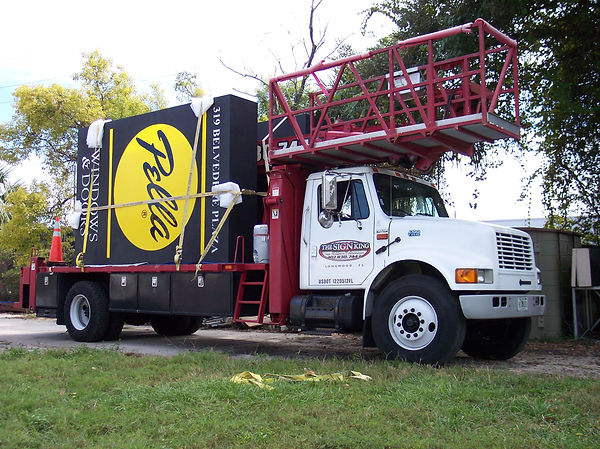 The Sign King Crane Truck With Pella Sign