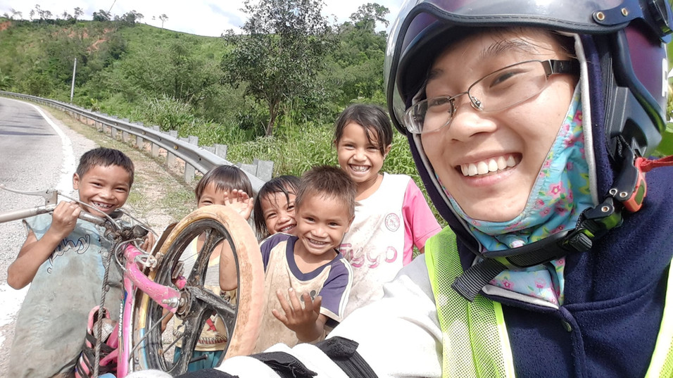 Young woman traveling on motorcycle through Vietnam countryside