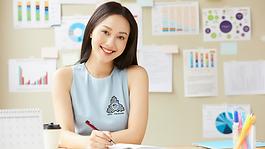 USA student advisor at her desk smiling