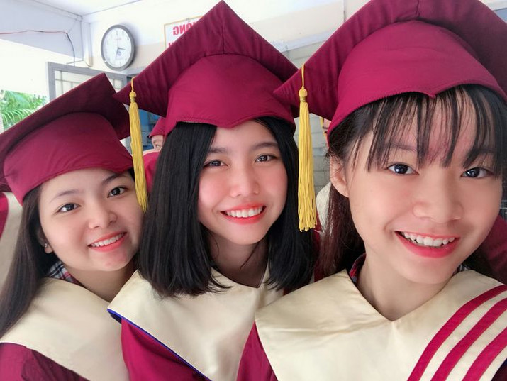 Three young middle school graduate. On graduation day