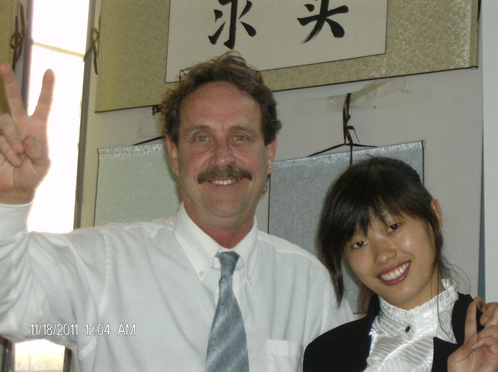 Teacher Edward in China  with teaching assistant, Ms.Ha
