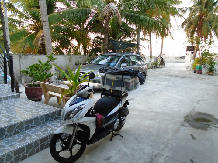 A high performance 125 motorcycle parked in front of a motor in in Vietnam