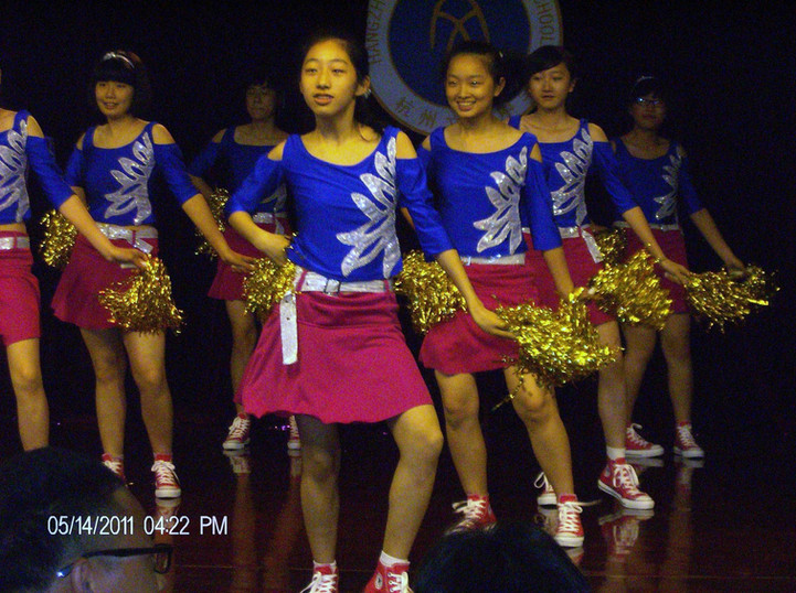 Students performing at cheerleading contest