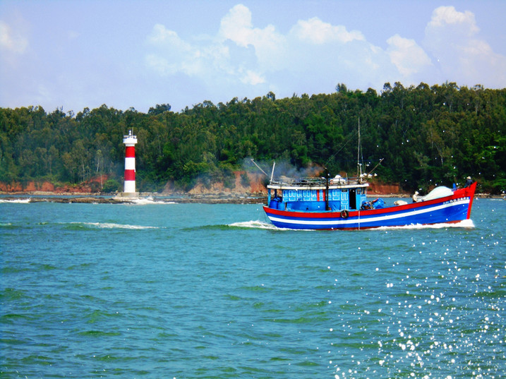 A beautiful day and a fishing boat traveling out to see in Vietnam