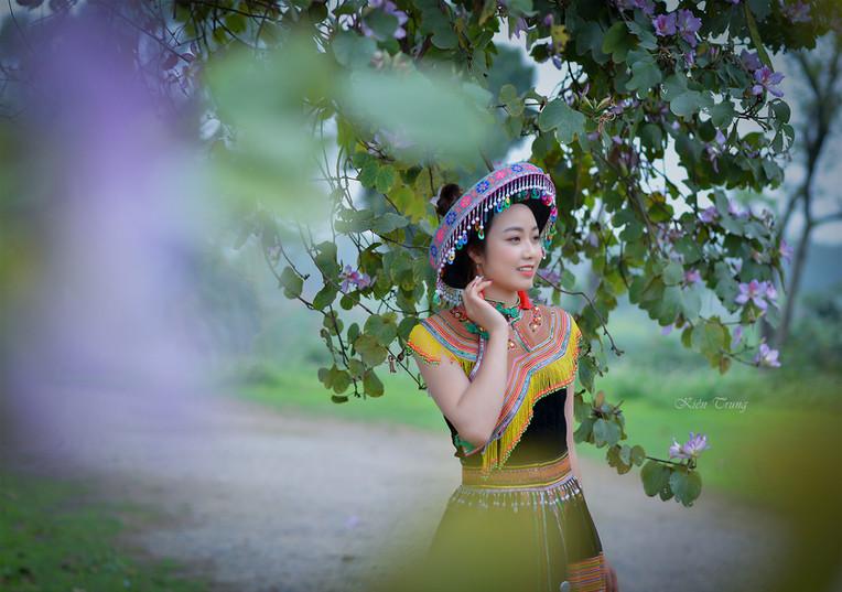 Beautiful northern Vietnamese woman walking in her traditional dress