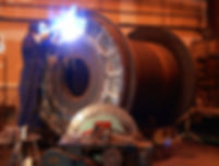 Ellery Manufacturing Employmet  Image of Welder woring on large steel drawworks drum roll.