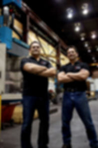 Paul Ellery and Dave Ellery standing on the Ellery manufaturing shop floor.