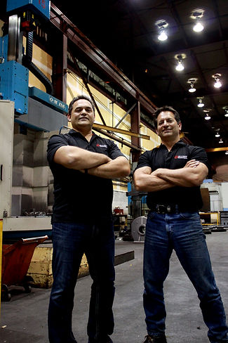 Paul Ellery and Dave Ellery standing on the Ellery manufaturing shop floor.