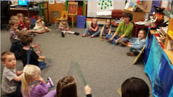 Young students sitting in circle