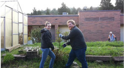 Students cleaning up courtyard