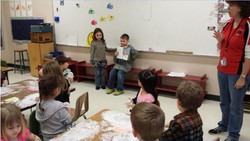 Two students present to class