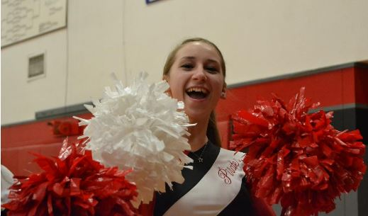 Student cheering with pom-poms