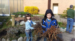 GES kids cleaning courtyard