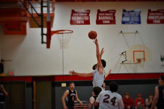 Basketball player shooting ball