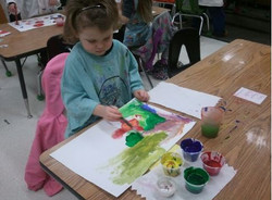 Young girl painting in class