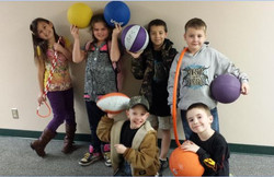 GES kids with recess equipment