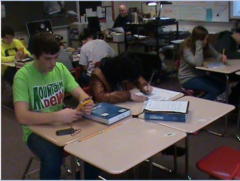 Students working in class at desks