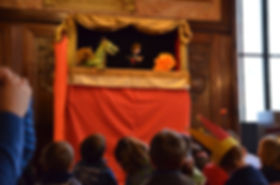 Puppet booth, kids watching