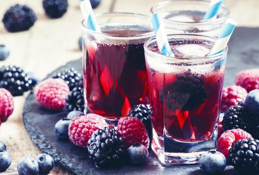Ice berry tea with raspberries, blackber