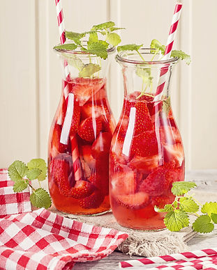 Summer drink with strawberry in glasses.