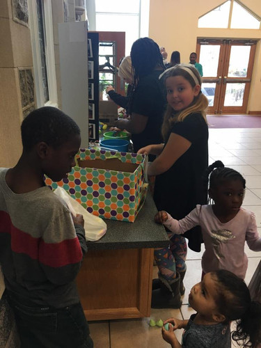 Emptying the eggs of their candy treasure