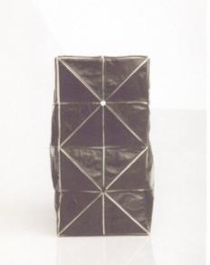 Origami handbag in canvas and python.
