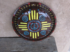 Painted Hub Cap by Patricia Brown