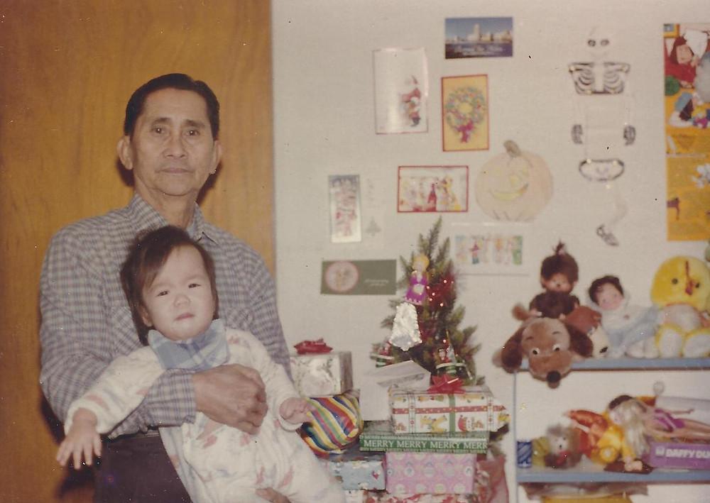 Baby Held By Grandpa