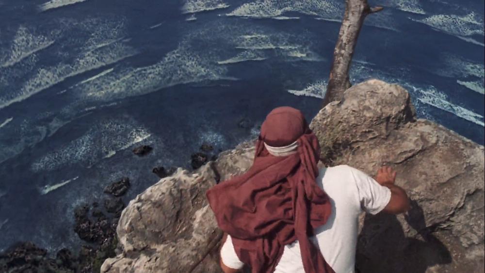 Cast AwayTom Hanks Chuck Noland looks down froma cliff top