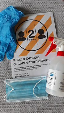 Covid19 sign, PPE, sanitising spray, face mask and gloves, health and safety equipment