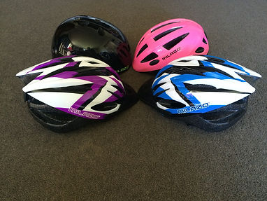 multi coloured childrens bike helmets for hire