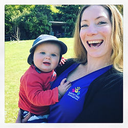 Lucy Deuble owner of Babysitting Queenstown holding a little boy