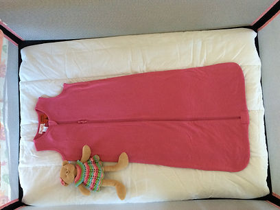 Jolly Jumper Roma travel cot, portacot with bedding, merino sleep sack and toy for holday hire in Queenstown with Rockababy Rentals