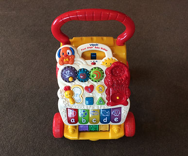 educational, talking, musical baby walker toy in hotel room NZ