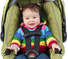happy girl in Rockababy Rentals car seat child restraint in Queenstown New Zealand on holiday